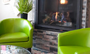 Comfy chairs by the fireplace at The Grind Coffee House
