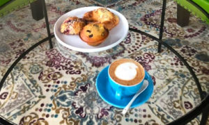 Kickapoo Coffee latte and fresh baked goods from Meringue Bakery at The Grind Coffee House