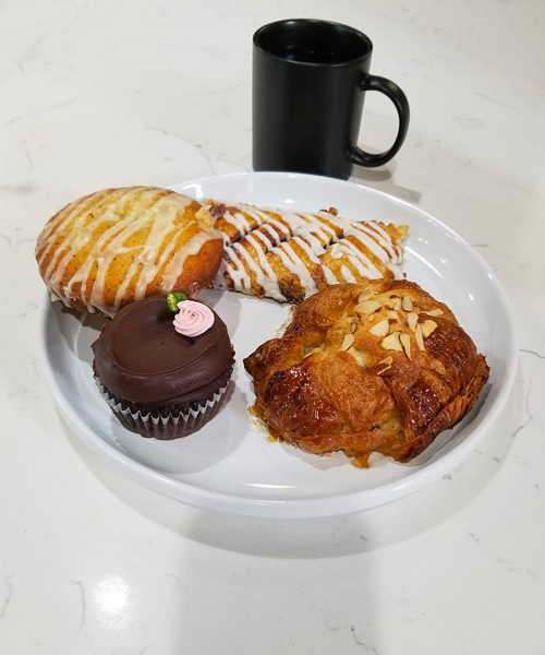 Kickapoo Coffee and fresh baked goods from Meringue Bakery at The Grind Coffee House
